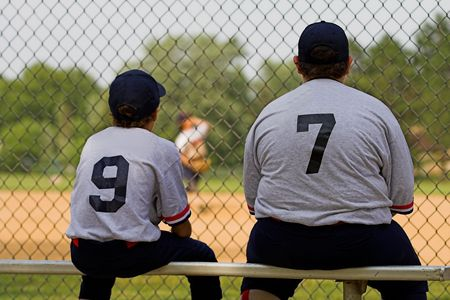 ballpark: two ball players on bench waiting to play