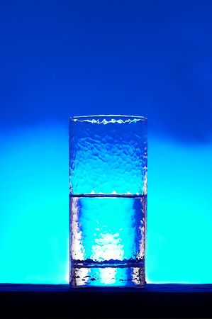 rehydration: water being poured into a glass from a plastic bottle Stock Photo
