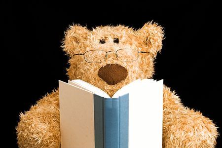 toy story: teddy bear with glasses reading a book