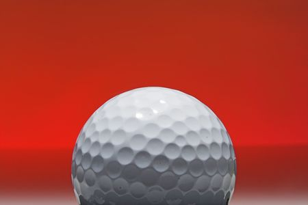golf ball isolated against red background Stock Photo - 514438