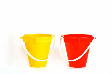 red and yellow beach toy buckets photo