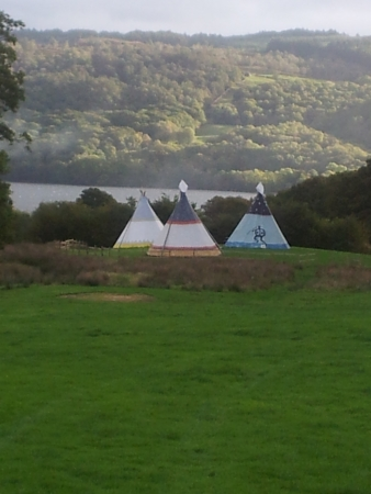 teepee: teepee,s on land above the lake Editorial