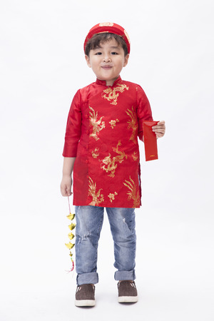 A kid feel happy when Tet Holiday comes
