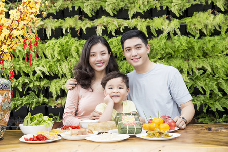 Vietnamese family enjoy new year with green wall background