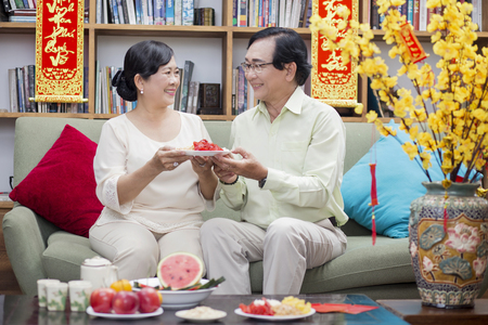 Vietnamese older couple celebrate lunar new year