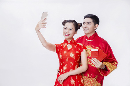 Chinese couple holding together and selfie together for new year