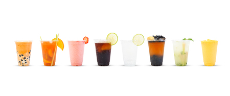 Different drinks in glass jugs on white background