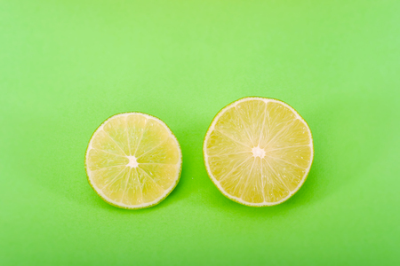 lemon slice, clipping path, isolated on a green background