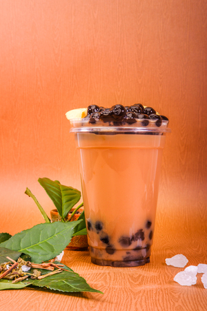 Iced milk tea with bubble and flan cake
