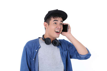 Young asian boys wearing blue and headphones 免版税图像