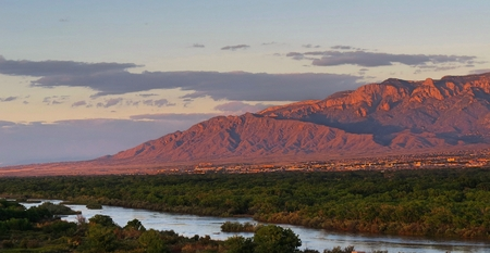 view of the Sandia Mountains and Rio Grande Bosque