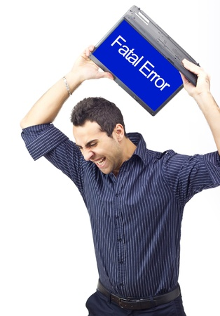 portable failure: Man throwing laptop because of a system error.White background Stock Photo