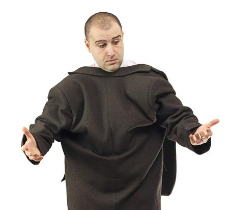 maldestro: Uomo d'affari Clumsy in fretta prendendo il suo sfondo reversed.White cappotto. Archivio Fotografico