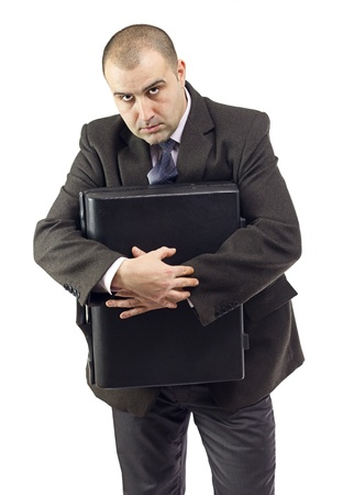 selfish: Selfish business man not giving information to others.Mad expression on his face.White background. Stock Photo