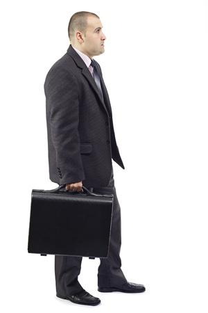 スーツケースを運んで、職場に彼の方法で大人のビジネス人の側面図