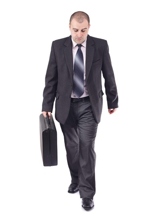 Front view of an adult business man in his way to the workplace,carrying the suitcase Stock Photo - 12964441