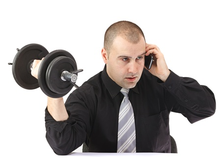 Adult business man on the phone doing fitness at work.White background photo