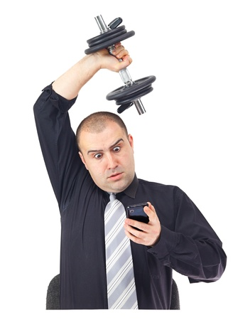 tired businessman: Adult business man on the phone doing fitness at work.White background Stock Photo