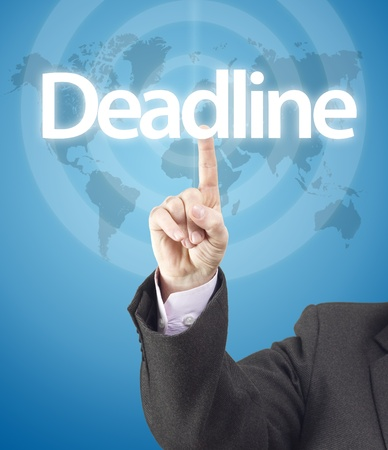 Business man hand pressing on deadline word.Gradient blue background with world map texture photo