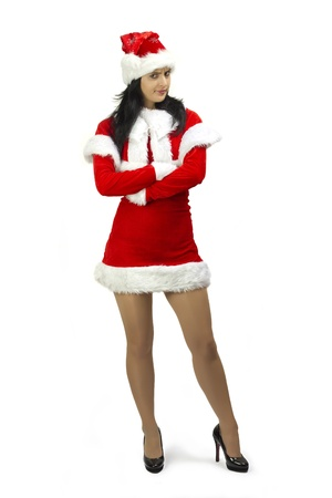 Angry woman dressed in Santa Claus costume with arms crossed photo