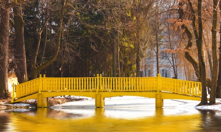 Spring landscape with yellow bridge over a lake Peaceful background Stock Photo - 13060851