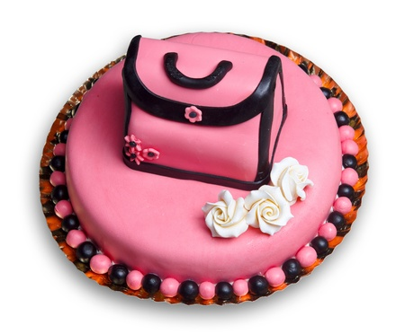 Birthday cake with pink frosting,decorated with a vintage woman handbag and flowers including three roses.White background. Imagens