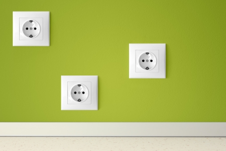 Green wall with three european electric outlets photo