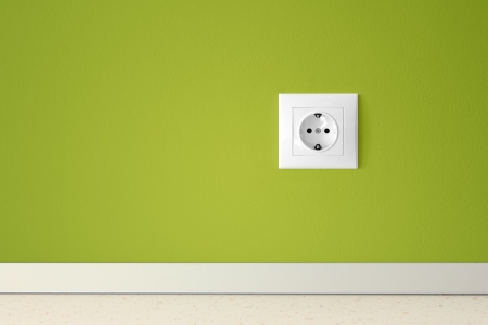 electric outlet: Green wall with european electric outlet