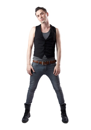 Portrait of young hipster male posing with tight pants and black boots photo