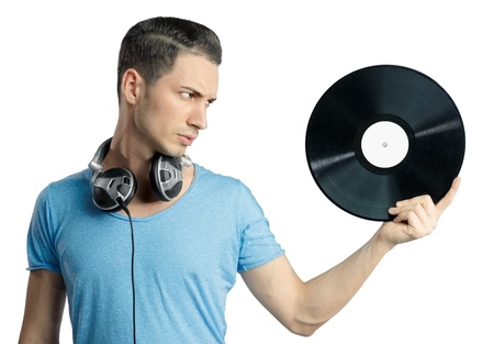 Young male having a serious expression while holding black vinyl in hand. Musical notes on gradient background. Stock fotó
