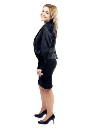 Elegant business woman posing and smiling to camera against white background. photo