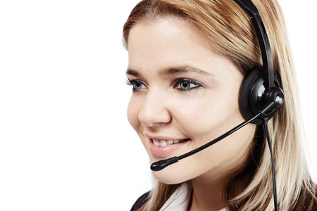 Smiling blonde woman with headphones at call center. Isolated on white Stock Photo - 18908446