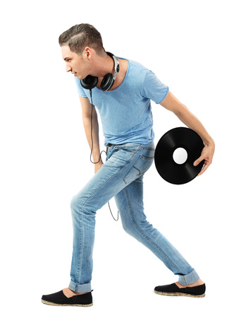 Handsome young caucasian male throwing vinyl disc on isolated white background. photo