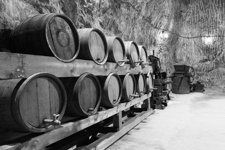Old wine barrels in Praid salt mine from Romania. photo