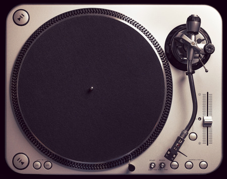Old good looking turntable without vinyl. Top view, vintage cross processing. You can place your own vinyl on it. photo