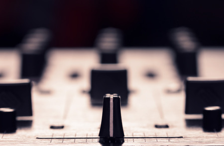 Closeup photo of sound mixer controller with focus on cross fader photo