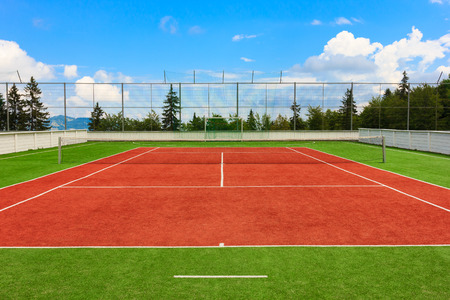 Synthetic outdoor tennis court in red and green