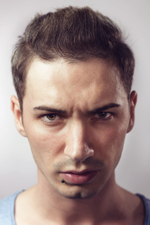 Portrait of young hipster male with piercing.Vintage effect. photo