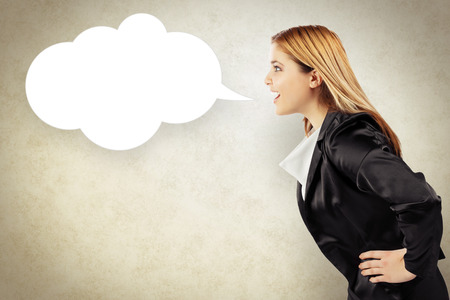 telling: Business woman telling a message in speech balloon Stock Photo