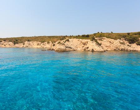 turqoise: Blue sea water near island during summer Stock Photo