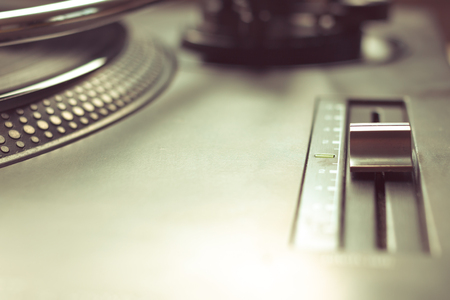 Pitch control in focus on vinyl player. Vintage effect.
