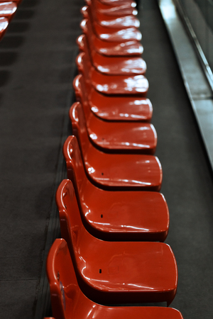 tribune: Red tribune seats in sport hall Stock Photo