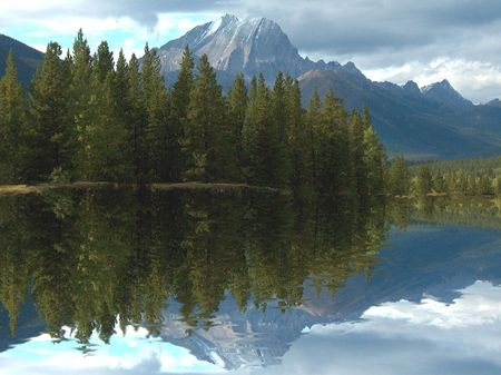 reflective: high snowcapped mountain with reflective lake in the foreground