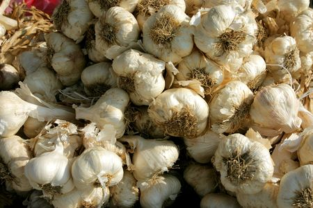 Garlic stall on a farmers market in greece photo