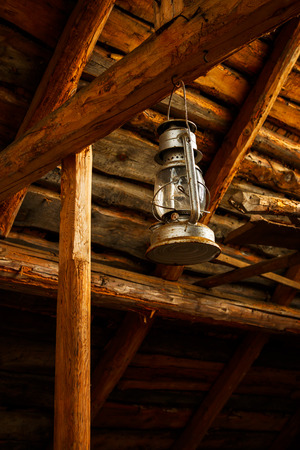 Oil lamp in old barn photo