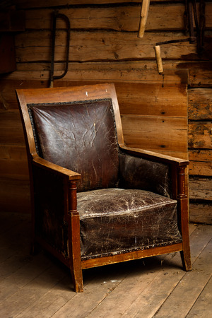 Old armchair in an old and dusty attic photo