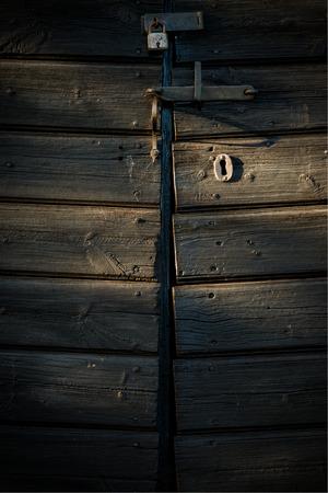 barndoor: Old lock on barn door in afternoon light (vertical)