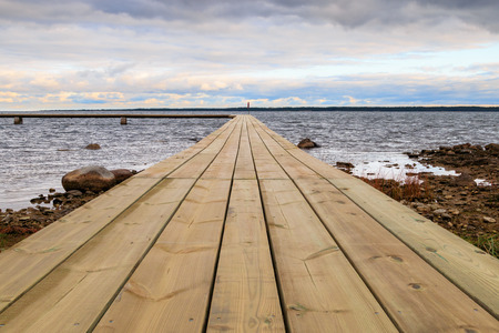Jetty by the water on Faro in Gotland, Sweden photo
