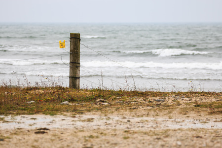 fencepost: Fence post by stormy sea in Gotland, Sweden