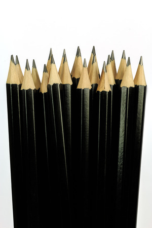 Close-up of several black pencils isolated with white background Stock Photo